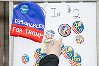 "A street vendor sells Trump-themed memorabilia as people gather near the National Mall to watch the inauguration of President Donald Trump on Jan. 20, 2017, in Washington, D.C. A beanie in the picture reads, ""Deplorables for Trump."""