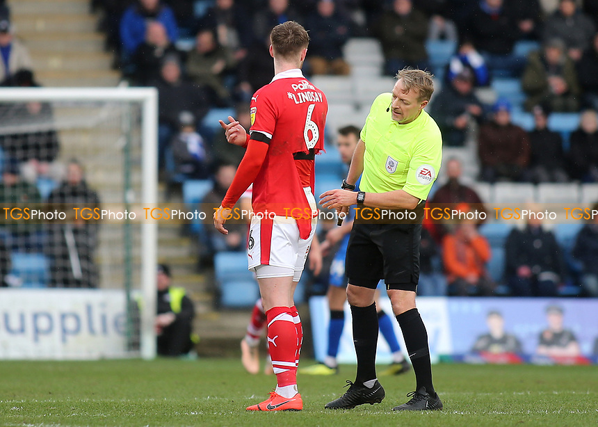 Referee, Trevor Kettle, inspects the shirt of Barnsley's Liam Lindsay and agrees he can head to the dug-out for a new one during Gillingham vs Barnsley, Sky Bet EFL League 1 Football at The Medway Priestfield Stadium on 9th February 2019