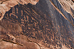 The rock art petrogplyphs of the Big Kachina Panel of Butler Wash are from the Basketmaker II culture, between 500 B.C. and 500 A.D.  It has anthropomorphic figures in a shamanistic theme.  San Juan River, Utah, USA.  This panel is often mistakenly called the Butler Wash Panel. which is actually located at the mouth of Butler Wash where it empties into the San Juan River.