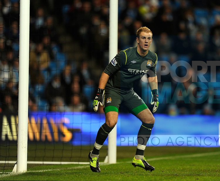 Joe Hart of Manchester City.The Carling Cup, Semi Final 1st leg.Manchester City v Liverpool at the Etihad Stadium, Manchester..11th January, 2012.--------------------.Sportimage +44 7980659747.picturedesk@sportimage.co.uk.http://www.sportimage.co.uk/.Editorial use only. Maximum 45 images during a match. No video emulation or promotion as 'live'. No use in games, competitions, merchandise, betting or single club/player services. No use with unofficial audio, video, data, fixtures or club/league logos.