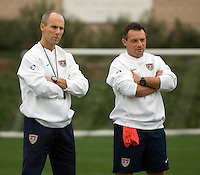 USMNT Head Coach Bob Bradley (l) observes training alongside Assistant Coach Peter Nowak.
