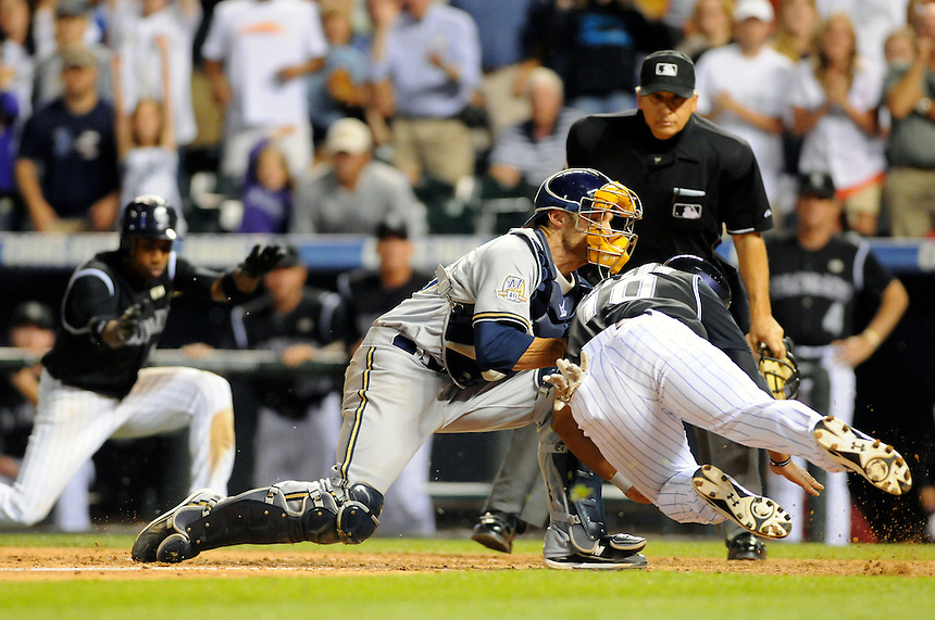19 JUNE 2010: Colorado Rockies shortstop Chris Nelson (10) scores a run as he collides with Milwaukee Brewers catcher Jonathan Lucroy (20) during a regular season Major League Baseball game between the Colorado Rockies and the Milwaukee Brewers at Coors Field in Denver, Colorado.   The Rockies beat the Brewers 8-7. *****For Editorial Use Only*****