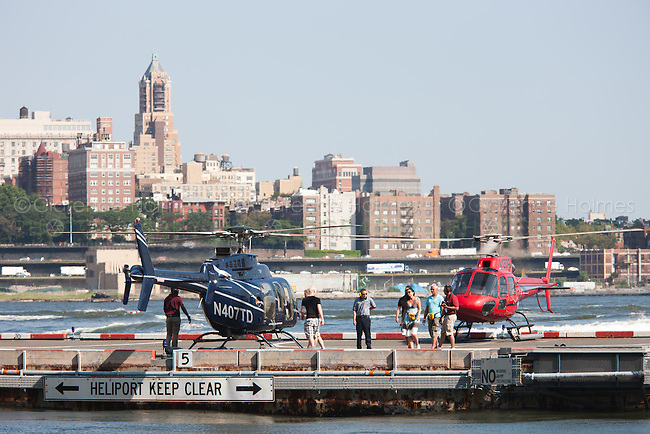 Passengers board helicopters at the Downtown Manhattan Heliport in New York City