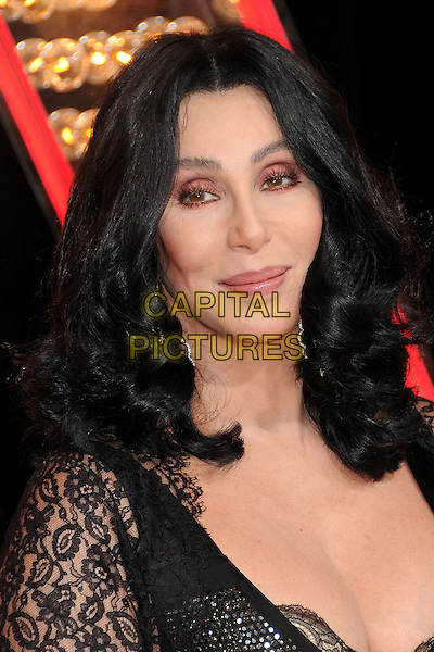 "CHER.""Burlesque"" Los Angeles Premiere held at Grauman's Chinese Theatre, Hollywood, California, USA..November 15th, 2010.headshot portrait black sparkly lace sleeve low cut cleavage silver wavy hair make-up beauty .CAP/ADM/BP.©Byron Purvis/AdMedia/Capital Pictures."