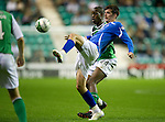 Hibs v St Johnstone...28.09.11   SPL Week.Cillian Sheridan and Isaiah Osbourne.Picture by Graeme Hart..Copyright Perthshire Picture Agency.Tel: 01738 623350  Mobile: 07990 594431
