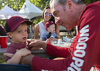 NWA Democrat-Gazette/CHARLIE KAIJO Mike Hernick of Cincinnati, OH. plays with his grandson Dawson Humphreys, 2, ahead of the first half of the game between Arkansas Razorbacks and New Mexico State Aggies on Saturday, September 30, 2017 at Razorback Stadium in Fayetteville.