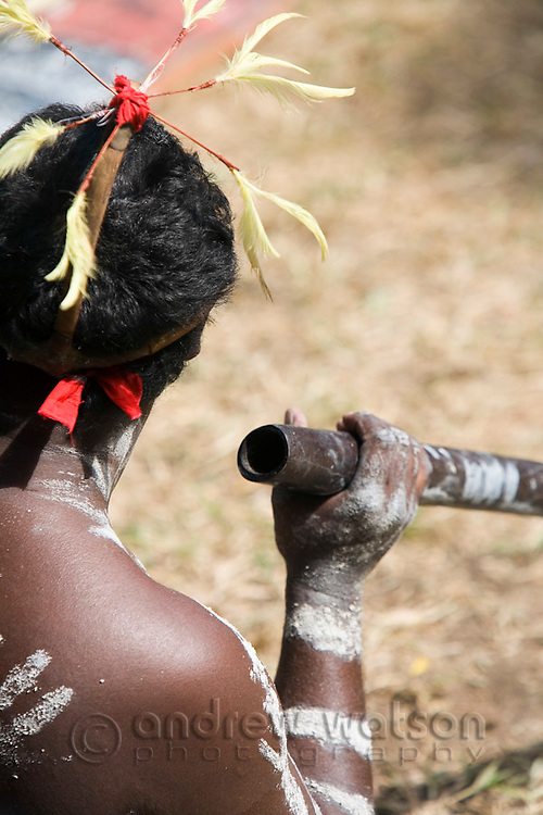 Indigenous man with didgeridoo at the Laura Aboriginal Dance Festival.  Laura, Queensland, Australia