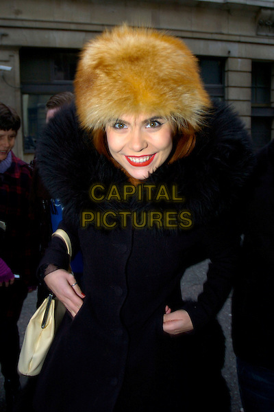 PALOMA FAITH.Seen at BBC Radio 2 Studios,.London, England, UK,.4th December 2009..half length brown fur hat black coat collar trim red lipstick make-up smiling hand sin pockets eye contact bag .CAP/DYL.©Dylan/Capital Pictures.