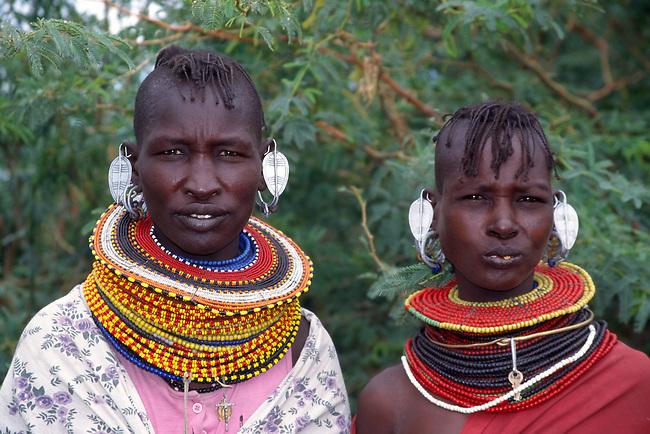 Africa. Kenya. Lake Turkana.Turkana women dressed in traditional jewerly and clothing....