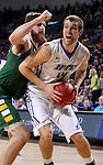 SIOUX FALLS, SD - MARCH 7:  Defender Dylan Miller #42 of North Dakota State tries to stop Joe Reed #44 of Fort Wayne in the 2016 Summit League Tournament.  (Photo by Dave Eggen/Inertia)