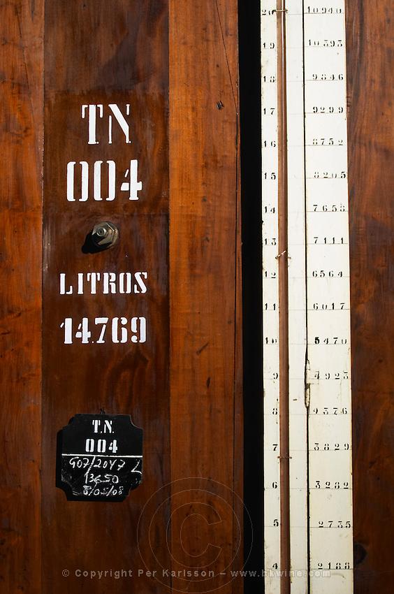 sign on tank measuring the volume sandeman port lodge vila nova de gaia porto portugal