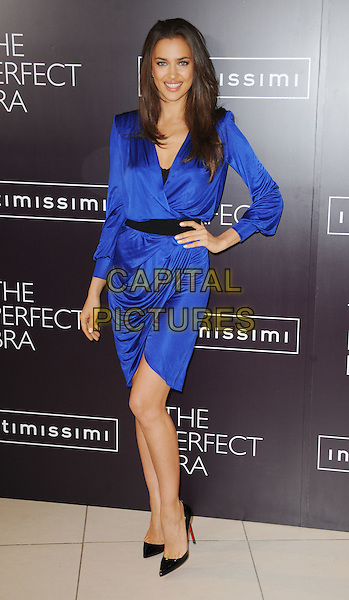 Irina Shayk (Irina Shaykhlislamova).launches Intimissimi Perfect Bra Collection and book at.Intimissimi, Oxford Street, London, England 24th April 2012.full length blue wrap dress black belt hand on hip.CAP/WIZ.© Wizard/Capital Pictures.