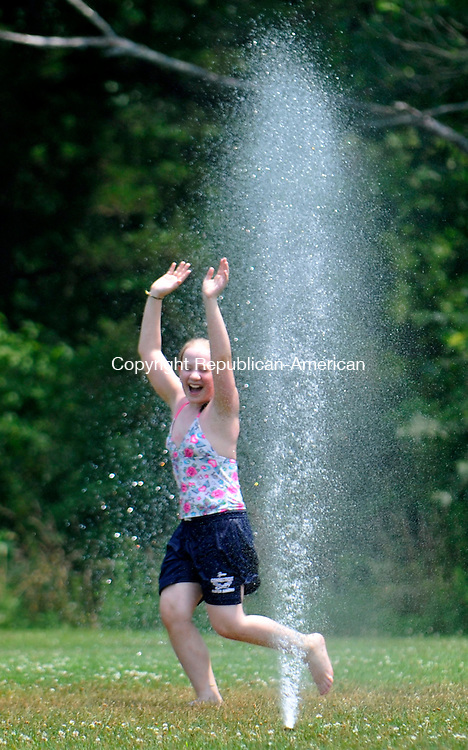 CHESHIRE, CT-07 JULY 2010-070710IP04- Miranda Boyne, 11, of Wolcott cools off in a sprinkler at Bartlem Park in Cheshire on Wednesday.<br /> Irena Pastorello Republican-American