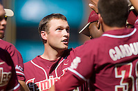 Tommy Oravetz #6 of the Florida State Seminoles is congratulated by teammates after hitting a home run versus the Miami Hurricanes at Durham Bulls Athletic Park May 21, 2009 in Durham, North Carolina.  (Photo by Brian Westerholt / Four Seam Images)