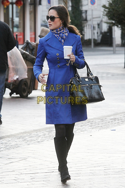 Pippa Middleton arrives for work, London, England..December 13th, 2011.full length sunglasses shades blue jacket scarf print bag purse boots black profile takeaway coffee drink beverage .CAP/HIL.©John Hillcoat/Capital Pictures .