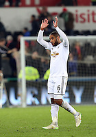 Monday 16 March 2015<br /> Pictured: Swansea's Ashley Williams waves at the crowd as he leaves the field at full-time.<br /> Re: Barclay's Premier League, Swansea City FC v Liverpool at the Liberty Stadium, south Wales, UK.