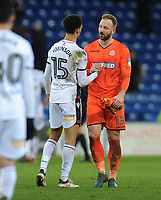 Bolton Wanderers' Ben Alnwick looks dejected as he shakes hands with Antonee Robinson at the final whistle<br /> <br /> Photographer Kevin Barnes/CameraSport<br /> <br /> The EFL Sky Bet Championship - Cardiff City v Bolton Wanderers - Tuesday 13th February 2018 - Cardiff City Stadium - Cardiff<br /> <br /> World Copyright &copy; 2018 CameraSport. All rights reserved. 43 Linden Ave. Countesthorpe. Leicester. England. LE8 5PG - Tel: +44 (0) 116 277 4147 - admin@camerasport.com - www.camerasport.com