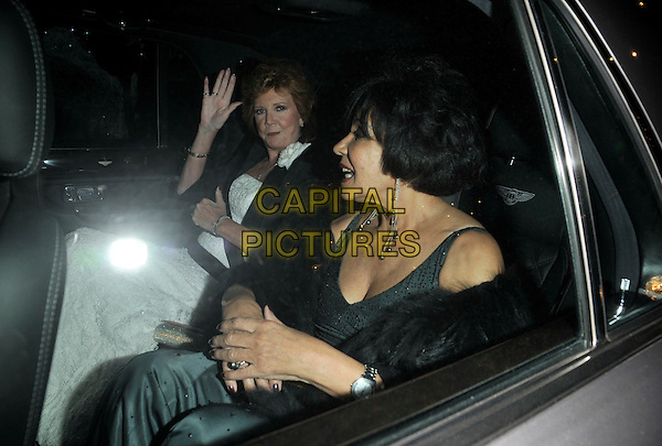 CILLA BLACK & DAME SHIRLEY BASSEY.Attending Bruce Forsythe's 80th Birthday Party, at The Dorchester Hotel, London, England, February 22nd 2008..half length sitting in car hand waving.CAP/CAN.?Can Nguyen/Capital Pictures