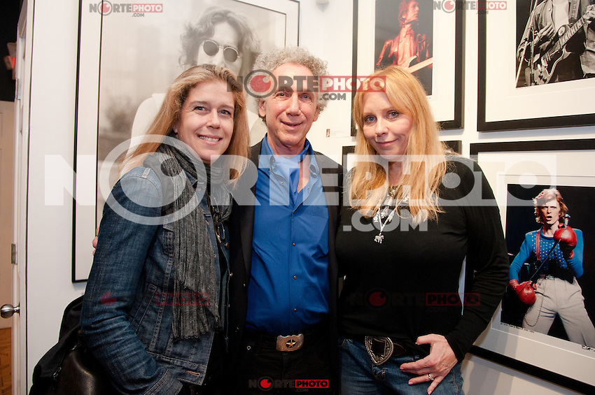 "Bob Gruen with Bebe Buell and guest at the Bob Gruen ""Rock Seen"" photo exhibition at Art629 in New York City. May 4, 2012. © Kristen Driscoll/MediaPunch Inc."