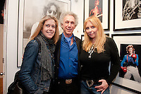 """Bob Gruen with Bebe Buell and guest at the Bob Gruen """"Rock Seen"""" photo exhibition at Art629 in New York City. May 4, 2012. ©Kristen Driscoll/MediaPunch Inc."""