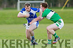 David McLoughlin Kerins O'Rahillys is held up by Legions Darragh O'Doherty during their club championship clash in Derreen on Saturday evening