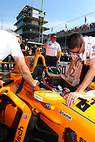 May 26, 2017; Indianapolis, IN, USA; Crew members help strap IndyCar Series driver Fernando Alonso into his car during Carb Day for the 101st Running of the Indianapolis 500 at Indianapolis Motor Speedway. Mandatory Credit: Mark J. Rebilas-USA TODAY Sports