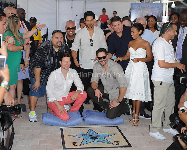 MIAMI, FL - JUNE 24: Gabriel Iglesias, Matt Bomer, Adam Rodríguez, Joe Manganiello, Channing Tatum and Jada Pinkett Smith attend Magic Mike XXL cast honored with stars on The Official Miami Walk Of Fame at Bayside Marketplace on June 24, 2015 in Miami, Florida. Credit: mpi04/MediaPunch