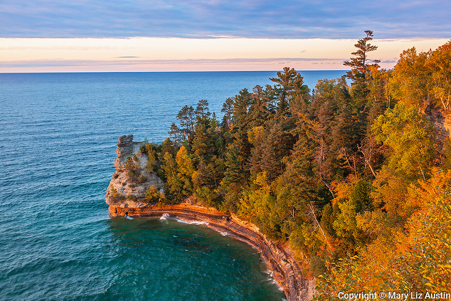 Pictured Rocks National Lakeshore, MI: Sunset lgiht after a clearing storm on Miner's Castle on Lake Superior in fall