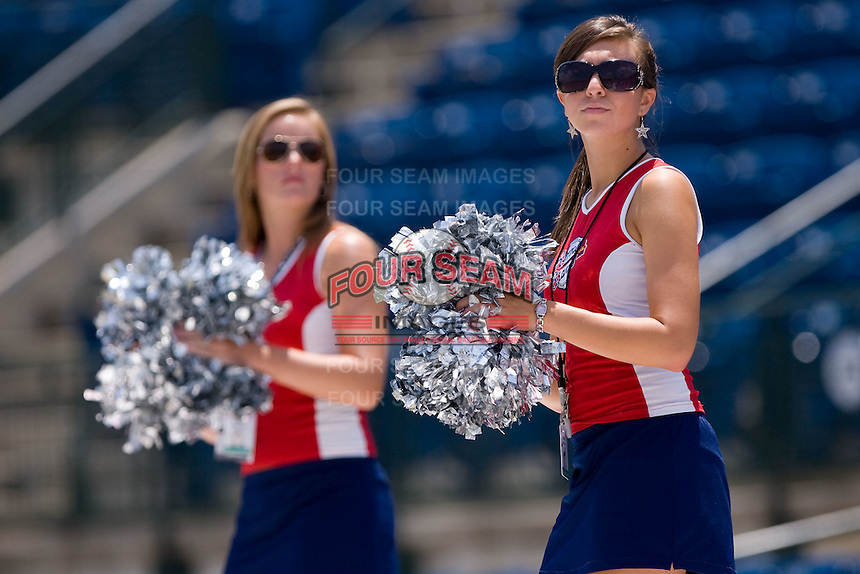 """Members of the """"Braves Brigade"""" entertain fans before the start of the South Atlantic League game between the Greenville Drive and the Rome Braves at State Mutual Stadium July 25, 2010, in Rome, Georgia.  Photo by Brian Westerholt / Four Seam Images"""