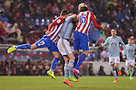 Atletico de Madrid's Lucas Hernández and Stefan Savic and Celta de Vigo's John Guidetti during La Liga match between Atletico de Madrid and Celta de Vigol at Vicente Calderon Stadium in Madrid, Spain. December 03, 2016. (ALTERPHOTOS/BorjaB.Hojas)