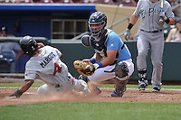 Manuel Margot (4) of the El Paso Chihuahuas is tagged out at home plate by Omaha Storm Chasers catcher Zane Evans (28) during the Pacific Coast League game at Werner Park on May 30, 2016 in Omaha, Nebraska.  The Chihuahuas defeated the Storm Chasers 12-0.  (Dennis Hubbard/Four Seam Images)