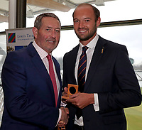 Graham Gooch (L) presents Nick Browne (R) with his County Championship winning medal during the Lord's Taverners Presentation at Lord's Cricket Ground on 12th March 2018