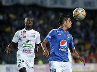 BOGOTA - COLOMBIA - 21 - 07 - 2016: David Silva (Der.) jugador de Millonarios disputa el balón Jhon Rendon (Izq.) jugador de Once Caldas, durante partido adelantado de la fecha 11 entre Millonarios y Once Caldas, de la Liga Aguila II-2016, jugado en el estadio Nemesio Camacho El Campin de la ciudad de Bogota.  / David Silva (R) player of Millonarios vies for the ball with Jhon Rendon (R) player of Once Caldas, during an advance match between Millonarios and Once Caldas, for the date 11 of the Liga Aguila II-2016 at the Nemesio Camacho El Campin Stadium in Bogota city, Photo: VizzorImage / Luis Ramirez / Staff.