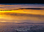 Sunset reflection on a lake during spring ice melt, Pocono Mountains, Pennsylvania