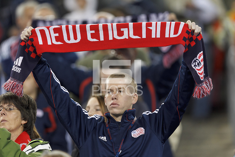 New England Revolution fan. In a Major League Soccer (MLS) match, the New England Revolution (blue) defeated Columbus Crew (white), 3-2, at Gillette Stadium on October 19, 2013.