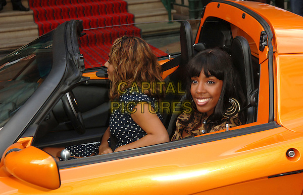 """KELLY ROWLAND.at the Lotus """"Project Eagle"""" celebrity unveiling at London Transport Museum at the Covent Garden Piazza,.London, England, UK, July 16th 2008..portrait headshot gold hoop earrings orange fringe sitting in car.CAP/WIZ.©Wizard/Capital Pictures"""
