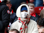 Liverpool fans with face masks during the Premier League match at Anfield, Liverpool. Picture date: 7th March 2020. Picture credit should read: Darren Staples/Sportimage