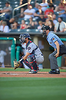 Jamie Ritchie (6) of the Round Rock Express on defense against the Salt Lake Bees with home umpire Lewis Williams handling the calls at Smith's Ballpark on June 10, 2019 in Salt Lake City, Utah. The Bees defeated the Express 9-7. (Stephen Smith/Four Seam Images)