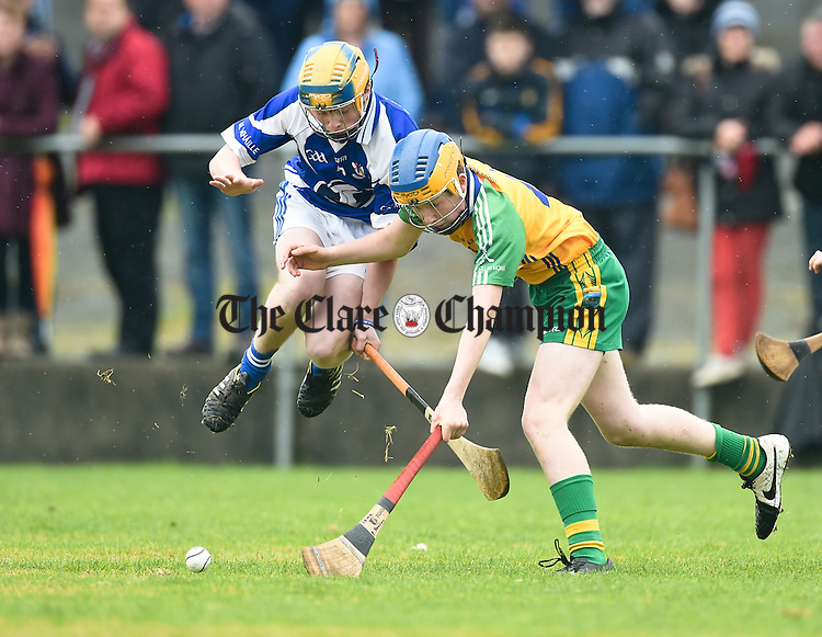 Ronan Cahill of Kilmaley in action against Padraig Devitt of Inagh-Kilnamona during the U-16A final in Clarecastle. Photograph by John Kelly.