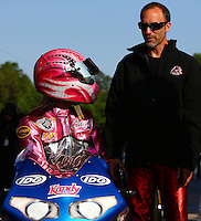 May 17, 2014; Commerce, GA, USA; NHRA pro stock motorcycle rider Angie Smith (left) with husband Matt Smith during qualifying for the Southern Nationals at Atlanta Dragway. Mandatory Credit: Mark J. Rebilas-USA TODAY Sports