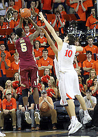 Florida State forward Jarquez Smith (5) is defended by Virginia forward/center Mike Tobey (10) during the second half of an NCAA basketball game Saturday Jan. 18, 2014 in Charlottesville, VA. Virginia defeated Florida State 78-66. (AP Photo/Andrew Shurtleff)