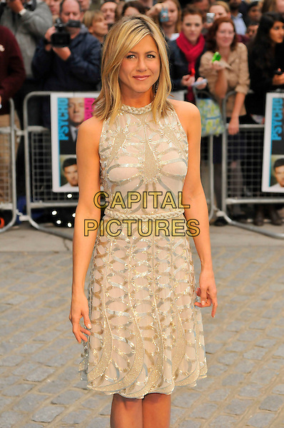 "Jennifer Aniston.""Horrible Bosses"" UK Premiere, BFI, London, England..20th July 2011.half 3/4 length length white cream dress sheer gold folds folded pleats pleated sleeveless braid braided belt sequins sequined .CAP/CAS.©Bob Cass/Capital Pictures."