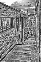 Looking down Advocate's Close in B&W in old Edinburgh.