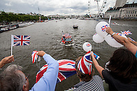 "London, 15/06/2016. Today, the River Thames outside the Houses of Parliament was the stage of an epic ""naval battle"" between the ""Brexit Flotilla"", lead by the UKIP leader Nigel Farage MEP, and the ""In Flotilla"", lead by the Irish singer-songwriter Bob Geldof KBE. Nigel Farage MEP lead a flotilla of fishing trawlers from Southend in Essex sailing to the River Thames in front of the British Parliament to call for the UK's withdrawal from the EU and to repossess ""our water back"". The protest and the counter protest were set to coincide with Prime Minister David Cameron question time.<br />