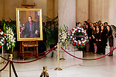 Law clerks and Supreme Court staff watch a private ceremony in the Great Hall of the United States Supreme Court where late Supreme Court Justice Antonin Scalia lies in repose in Washington, DC on Friday, February 19, 2016. At left is a portrait of Scalia. <br /> Credit: Jacquelyn Martin / Pool via CNP