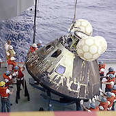 Crewmen aboard the U.S.S. Iwo Jima, prime recovery ship for the Apollo 13 mission, hoist the Command Module aboard ship. The Apollo 13 crewmen were already aboard the Iwo Jima when this photograph was taken. The Apollo 13 spacecraft splashed down at 12:07:44 p.m., April 17, 1970 in the South Pacific Ocean..Credit: NASA via CNP