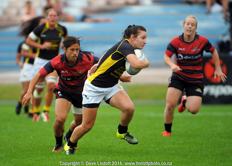 Wellington's Georgia Daals strips the ball from Keshia Grant and heads for the tryline during the women's semifinal match between Wellington and Canterbury on day two of the Bayleys National Sevens at Rotorua International Stadium, Rotorua, New Zealand on Sunday, 17 January 2015. Photo: Dave Lintott / lintottphoto.co.nz