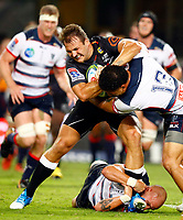 DURBAN, SOUTH AFRICA - MARCH 23: Billy Meakes and Sione Tuipulotu of the Melbourne Rebels tackling Andre Esterhuizen of the Cell C Sharks during the Super Rugby match between Cell C Sharks and Rebels at Jonsson Kings Park on March 23, 2019 in Durban, South Africa. Photo: Steve Haag / stevehaagsports.com