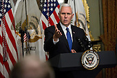 United States Vice President Mike Pence speaks before swearing in U.S. Secretary of Education Betsy DeVos, not pictured, in the Vice President's Ceremonial Office in Washington, D.C., U.S., on Tuesday, Feb. 7, 2017. DeVos squeaked through a history-making Senate confirmation vote to become U.S. education secretary, as Vice President Mike Pence broke a 50-50 tie and Republicans staved off last-minute defections that would have killed her nomination. <br /> Credit: Andrew Harrer / Pool via CNP