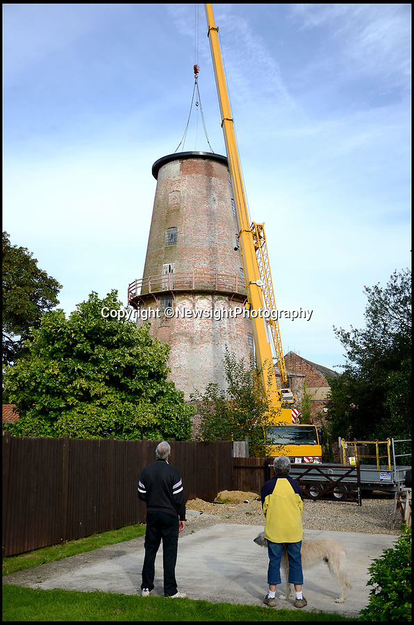 """BNPS.co.uk (01202 558833)Pic: NewsightPhotography/BNPS<br /> <br /> The traditional boat shaped cap has been removed.<br /> <br /> A campaign to save one of Britain's tallest windmills is in a race against time after the building was put up for auction.<br /> <br /> Campaigners hoping to buy Sutton Mill in North Norfolk and create a millwriting school that would safeguard the future of all UK mills have just seven days left to raise £85,000 so they can put in a bid.<br /> <br /> Steve Temple and Jonathan Cook set up the National Millwriting Centre, a community interest company, to create a skills programme and school to train apprentices and had set their sights on Sutton Mill as the ideal spot.<br /> <br /> Over the last year they have been working towards buying the mill and surrounding grounds and had already secured £450,000 in loans and grants to buy the site.<br /> <br /> But they needed to raise £150,000 in working capital before they can get that money and were working towards this when they were caught off-guard on March 1 as the current owner put the property up for auction """"without warning""""."""